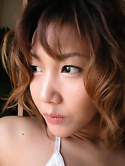 A busty Japanese beauty posing nude here