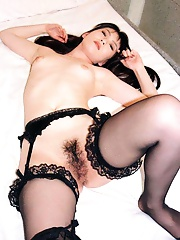 Long haired asian wife dildos her pussy
