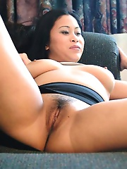 Busty asian girl fingers her shaved twat
